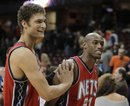 New Jersey Nets ' Brook Lopez , left, and Travis Outlaw celebrate after the Nets' 95-87 win over the Cleveland Cavaliers in an NBA basketball game Wednesday, Nov. 10, 2010, in Cleveland. The win snapped the Nets' five-game losing streak.