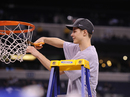 Duke's Jon Scheyer cuts a piece of the net after Duke's 61-59 win over Butler in the men's NCAA Final Four college basketball championship game Tuesday, April 6, 2010, in Indianapolis.
