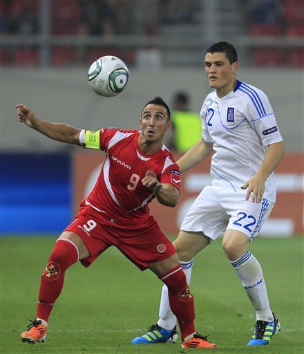 Kyriakos Papadopouos Of Greece, Right, Challenge For The Ball With Michael Mifsud Of Malta