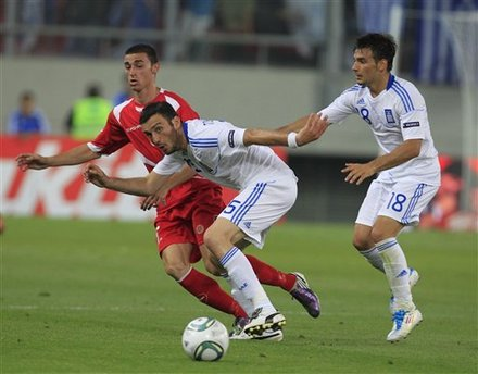 Vassilis Torossidis, Center, And Sotiris Ninis Of Greece, Right, Challenge For The Ball With Ryan Fenech Of Malta