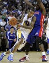 Golden State Warriors ' Monta Ellis (8) drives past Detroit Pistons ' Rodney Stuckey during the first half of an NBA basketball game Monday, Nov. 15, 2010, in Oakland, Calif.