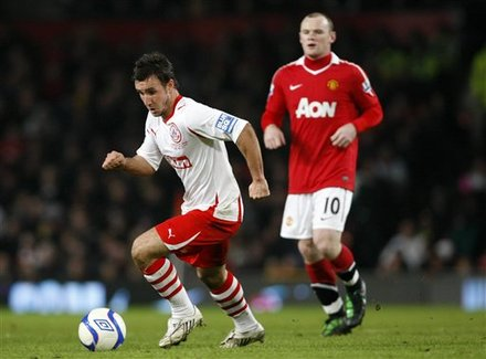 Manchester United''s Wayne Rooney, Right, Looks