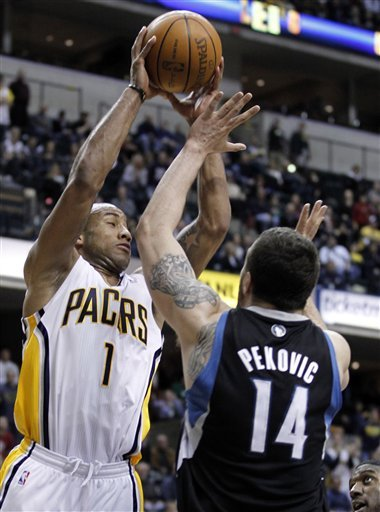 Indiana Pacers Guard Dahntay Jones, Left, Shoots