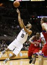 San Antonio Spurs ' Tony Parker , left, of France, shoots between Philadelphia 76ers ' Spencer Hawes , right, and Elton Brand during the first half of an NBA basketball game, Saturday, Nov. 13, 2010, in San Antonio. San Antonio won 116-93.