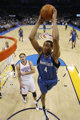 Minnesota Timberwolves Guard Wesley Johnson, Right, Goes