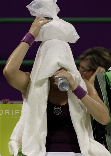 Russia's Vera Zvonareva Drinks Water As She Holds An Ice Bag On Top Of Her Head In A Match With Serbia's Jelena