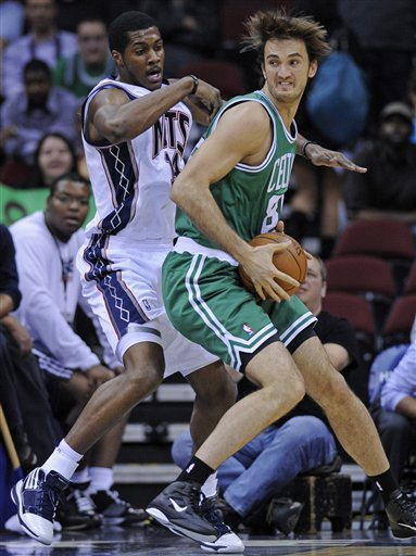 Boston Celtics Center Semih Erden, Right, Of Turkey, Looks