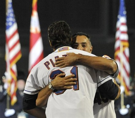 Former New York Mets Closer John Franco, Right, Embraces