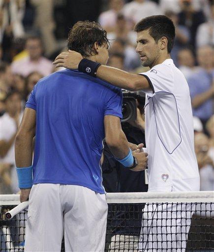 Novak Djokovic Of Serbia, Right, Shakes