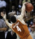 Colorado guard Alec Burks is fouled by Texas guard Dogus Balbay (4) as Burks shoots during the second half of an NCAA college basketball game in Boulder, Colo., on Saturday, Feb. 26, 2011. Burks had 33 points as Colorado upset Texas 91-89.