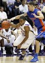 Florida guard Scottie Wilbekin, right, attempts to strip the ball from LSU guard Daron Populist in the second half of an NCAA college basketball game in Baton Rouge, La., Sunday, Feb. 20, 2011. Florida defeated LSU 68-61.