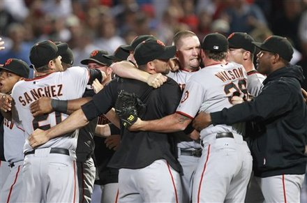 The San Francisco Giants celebrate after defeating the Atlanta Braves 3-2 in Game 4 of baseball's National League Division Series,  Monday, Oct. 11, 2010,  in Atlanta.