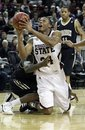 Mississippi State forward Kodi Augustus (24) shoots from his knees as he is fouled by Vanderbilt center Festus Ezeli left, in the first half of their NCAA college basketball game in Starkville, Miss., Thursday, Jan. 27, 2011. Augustus made the basket but Mississippi State lost to No. 19 Vanderbilt 81-74.