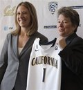 Sandy Barbour, right, California athletic director, presents Cal's newly named women's basketball coach, Lindsay Gottlieb, with a team jersey during a news conference announcing Gottlieb's appointment Tuesday, April 26, 2011, in Berkeley, Calif.