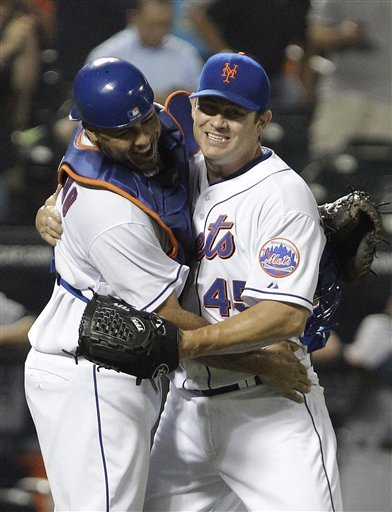 New York Mets Catcher Ronny Paulino, Left, Celebrates