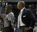 North Texas coach Johnny Jones, right, talks to official Earnie Pheal during a first-half timeout in an NCAA college basketball game against Mississippi State in Starkville, Miss., Sunday, Nov. 27, 2011. (AP Photo Jim Lytle)