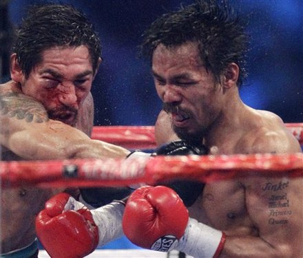 Manny Pacquiao, Right, And Antonio Margarito, Left, Exchange Blows