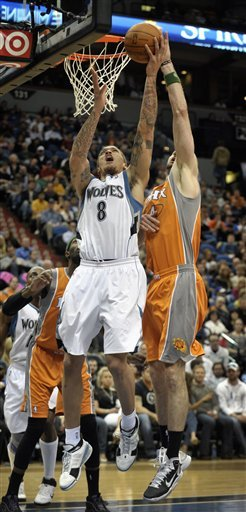 Minnesota Timberwolves' Michael Beasley (8) Gets Off A Shot In Front Of Phoenix Suns' Marcin Gortat, Right, Of Poland,