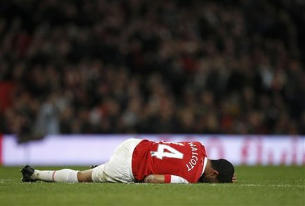 Arsenal''s Theo Walcott Lies On The Pitch With An Injury That Ended The Game For Him, Following A Challenge With Stoke