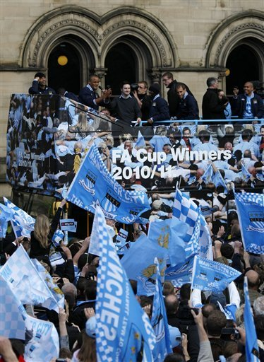 Manchester City Players Parade The FA Cup In Front Of Fans At The Start Of An Open Top Bus Parade At The Manchester