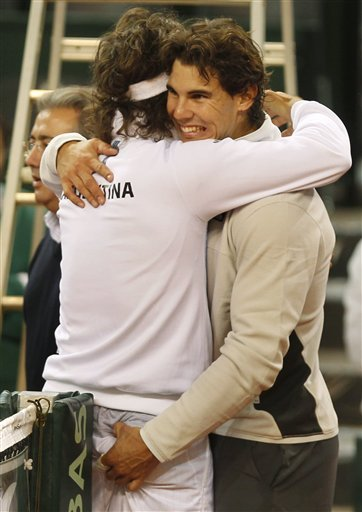 Rafael Nadal, Right, And  Juan Monaco From Argentina, Left, Hug Each Other