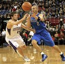 Dallas Mavericks guard Jason Kidd , right, pass off against Sacramento Kings guard Beno Udrih , left, of Slovenia, during the first quarter of an NBA basketball game in Sacramento, Calif., Saturday, Dec. 4, 2010.