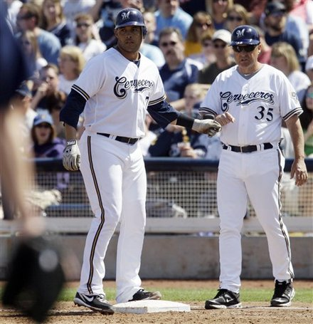 Milwaukee Brewers' Erick Almonte, Left, Celebrates