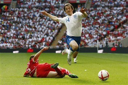 England's Leighton Baines, Right, Is