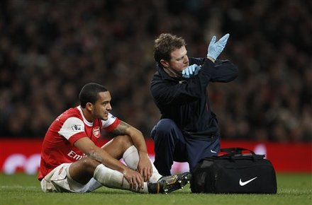 Arsenal''s Theo Walcott, Left, Reacts