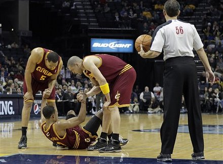 Cleveland Cavaliers Players Ryan Hollins (5) And Anthony Parker Help Teammate Ramon Sessions (3) With A Minor Injury
