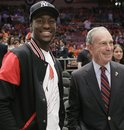 Connecticut guard Kemba Walker, left, chats with New York Mayor Michael Bloomberg before Game 4 of a first-round NBA basketball playoff series between the New York Knicks and the Boston Celtics at Madison Square Garden in New York, Sunday, April 24, 2011.