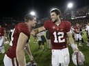 Stanford quarterback Andrew Luck (12) celebrates with Stanford linebacker Chase Thomas (44) after an NCAA college football game against Washington Saturday, Oct. 22, 2011, in Stanford, Calif. Stanford defeated Washington 65-21.