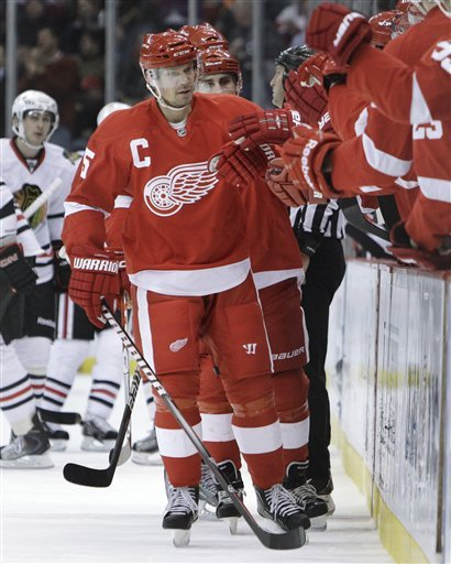 Detroit Red Wings defenseman Nicklas Lidstrom (5), of Sweden, is congratulated after scoring a goal against the Chicago Blackhawks in the first period of an NHL hockey game in Detroit, Monday, March 28, 2011. Lidstrom became the NHL's first 40-year-old defenseman with 60 points in a season with the goal.