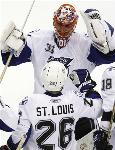 Tampa Bay Lightning's Martin St Louis (26) Is Congratulated By Teammate Tampa Bay Lightning Goalie Dwayne Roloson (31)