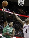 Boston Celtics guard Rajon Rondo (9) shoots next to Cleveland Cavaliers forward Antawn Jamison (4) in the first quarter quarter of an NBA basketball game Tuesday, Nov. 30, 2010, in Cleveland. Rondo scored a team-high 23 points in the Celtics' 106-87 win.