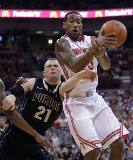 Ohio State 's David Lighty, right, is fouled by Purdue's D.J. Byrd as he grabs a rebound during the first half of an NCAA college basketball game Tuesday, Jan. 25, 2011, in Columbus, Ohio.