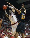 Alabama forward JaMychal Green (1) shoots against Virginia Commonwealth center D.J. Haley (33) during the second half of an NCAA college basketball game in Tuscaloosa, Ala., on Sunday Nov. 27, 2011. Alabama won 72-64.