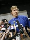 Dallas Mavericks center Dirk Nowitzki answers reporters question during media availability, Friday, May, 27, 2011, in Dallas. The Mavericks will play the Miami Heat in the NBA basketball finals starting next week.