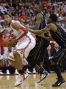 Ohio State 's Jared Sullinger, left, looks for an open shot against Purdue's JaJuan Johnson, center, and Terone Johnson during the second half of an NCAA college basketball game Tuesday, Jan. 25, 2011, in Columbus, Ohio. Ohio State beat Purdue 87-64.