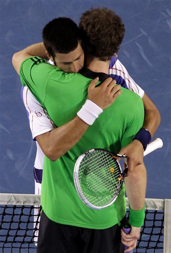 Britain's Andy Murray, Front, And Serbia's Novak Djokovic Hug At The Net