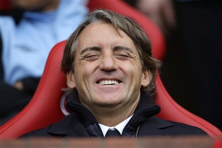 Manchester City's Manager Roberto Mancini Laughs