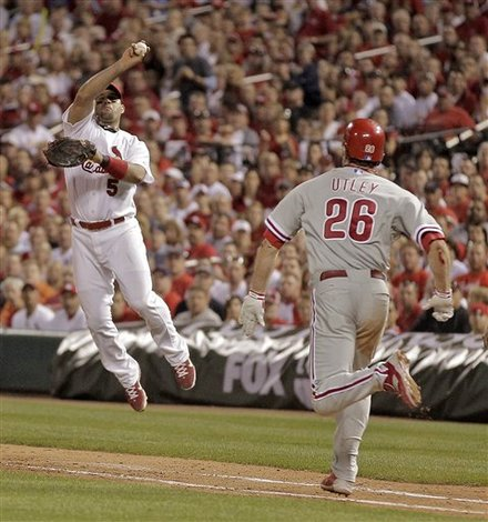 St. Louis Cardinals First Baseman Albert Pujols (5) Fields On-the-hop A Single Hit By Philadelphia Phillies' Chase