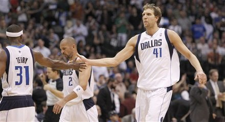 Dallas Mavericks power forward Dirk Nowitzki (41) of Germany gets a slap from teammate Jason Terry after Nowitzki scored during the fourth quarter of the NBA basketball game against the Minnesota Timberwolves in Dallas,  Thursday, March 24, 2011. Nowitzki had 30 points and 11 rebounds, Terry added 18 points and the Mavericks rallied in the fourth quarter for a 104-96 victory over the Timberwolves, giving Dallas 50 wins for the 11th straight season.
