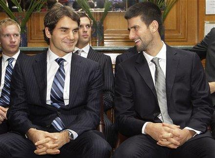 Roger Federer Of Switzerland, Left, Talks