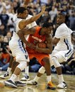 Syracuse guard Scoop Jardine, center, is pressured by Villanova gurad Corey Fisher and forward Antonio Pena, right, during the second half of an NCAA college basketball game, Monday, Feb. 21, 2011, in Philadelphia. No. 17 Syracuse won 69-64.