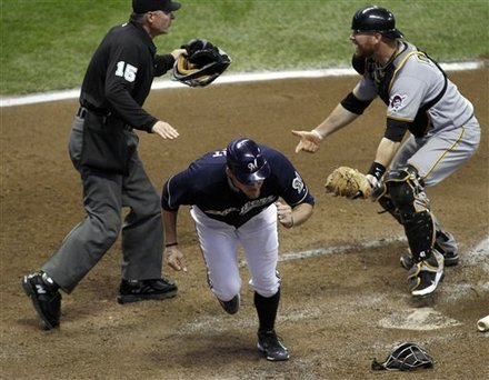 Milwaukee Brewers' Corey Hart, Center, Is