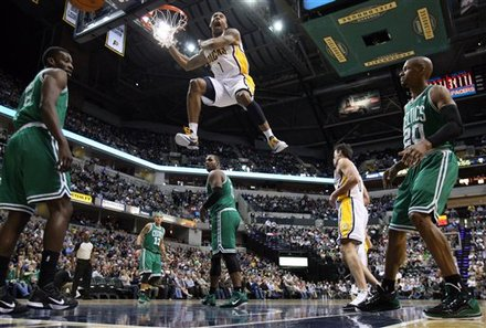 Indiana Pacers guard Dahntay Jones screams as he dunks between Boston Celtics players, left to right, Jeff Green , Delonte West , Glen Davis and Ray Allen in the second half of an NBA basketball game in Indianapolis, Monday, March 28, 2011. The Pacers defeated the Celtics 107-100.