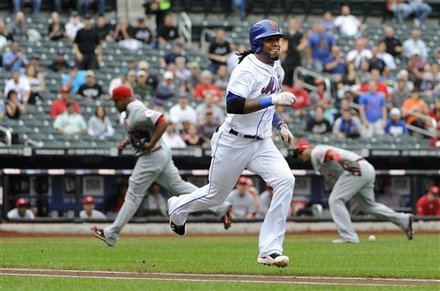 New York Mets' Jose Reyes Runs To First Base For A Bunt Single Off Cincinnati Reds Pitcher Edinson Volquez In The First