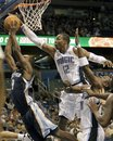 Memphis Grizzlies shooting guard Tony Allen , left, goes up as Orlando Magic center Dwight Howard (12) tries to block the shot during the first half of an NBA basketball game in Orlando, Fla., Monday, Nov. 15, 2010.