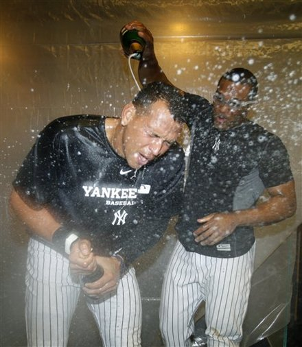 New York Yankees Robinson Cano, Right, Sprays